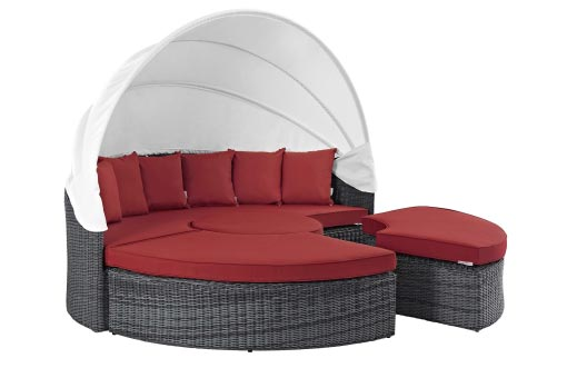 Modular daybed with red pillow-tops and white canopy attachment