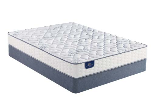 Undressed Serta Perfect Sleeper mattress on a blue foundation