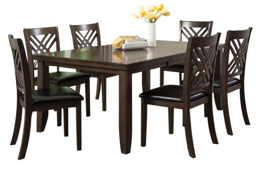 Dark brown wood dining table with tapered legs and cross-back chairs with black upholstered seat cushions