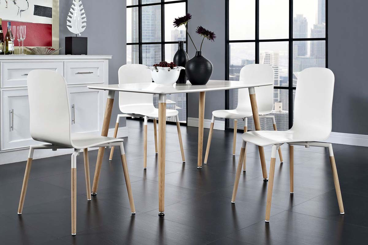 Contemporary dining room set with slim wood legs and white curve back plasic chair tops and table top