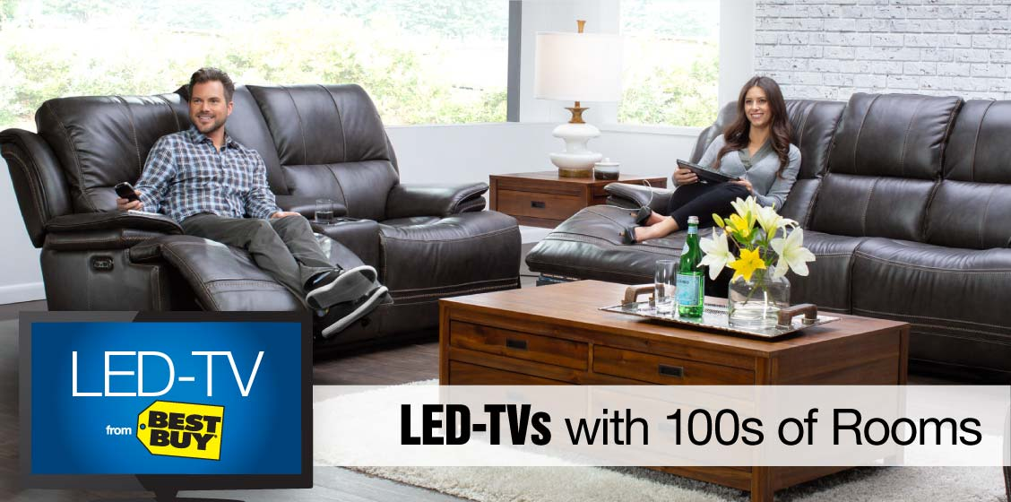Couple sitting in power reclining leather furniture set with the image of an LED-TV inset and the words 'LED-TVs with 100s of Rooms'