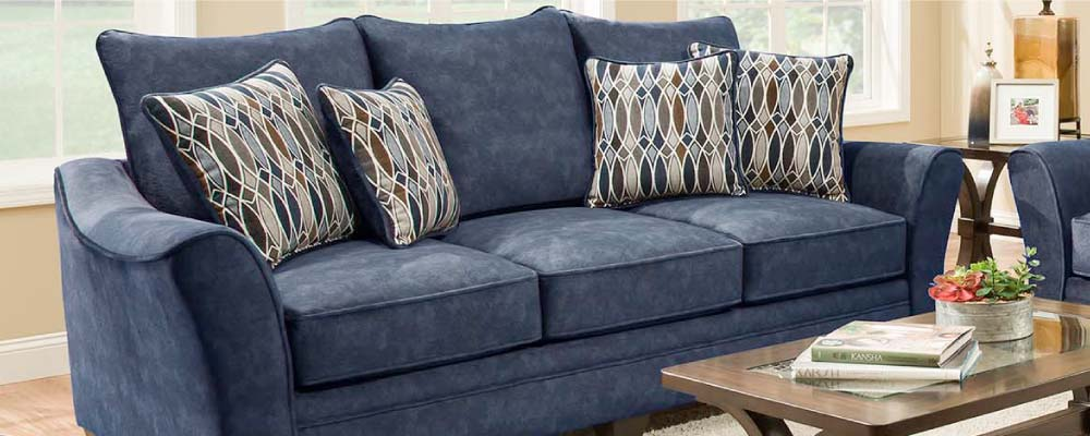 Blue sofa with swoop track arms and the look of velvet