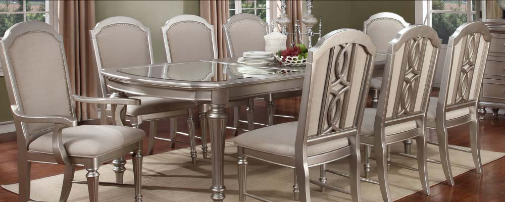 Hollywood Regency styled dining room with silver shimmering finish and mirror top on table