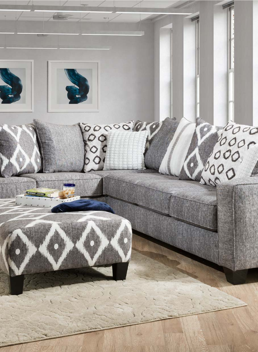 Contemporary grey sectional with bold pillow back design