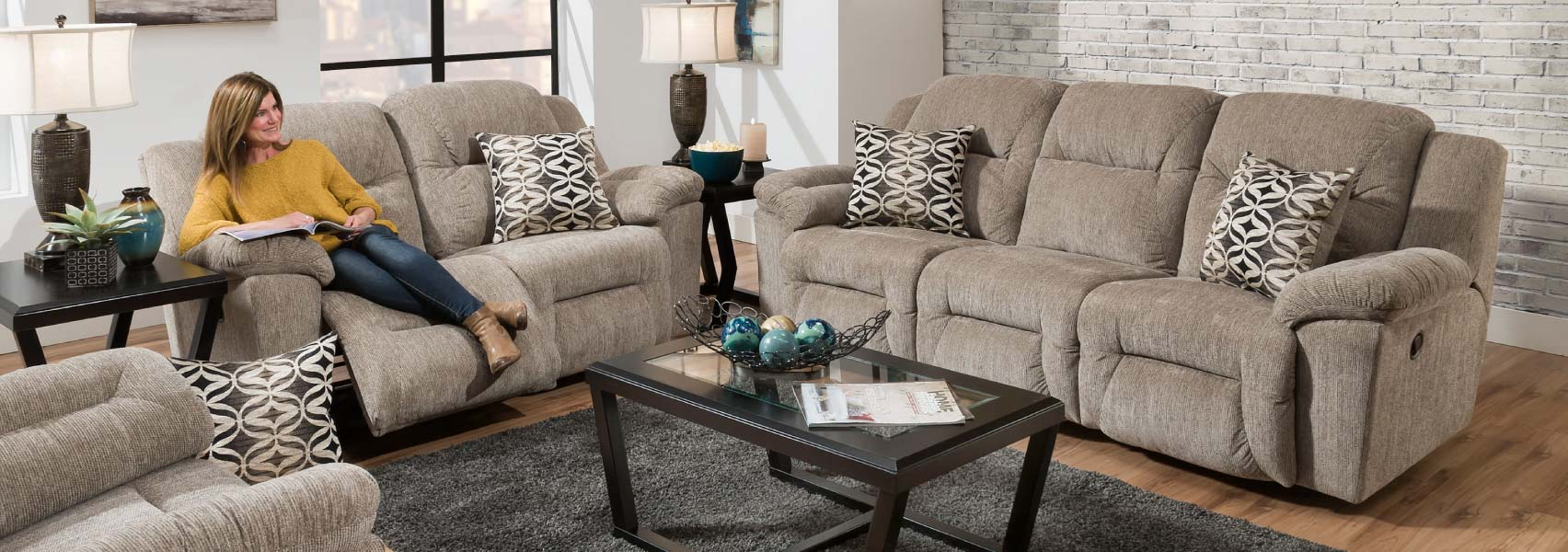Comfortable traditional style reclining sofa and loveseat in taupe