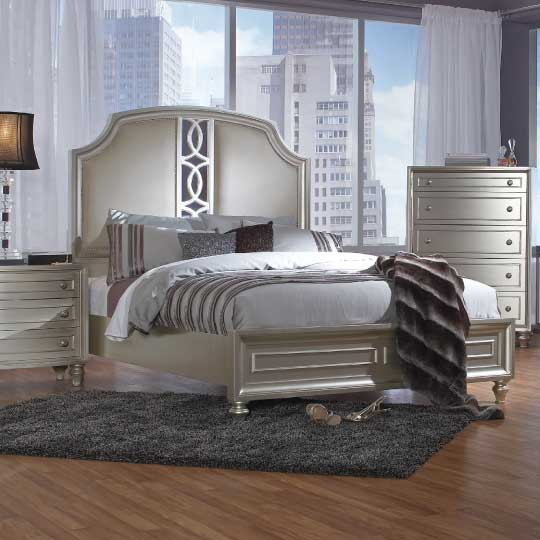 Champagne silver bedroom set with dramatic upholstered headboard and mirror inlays
