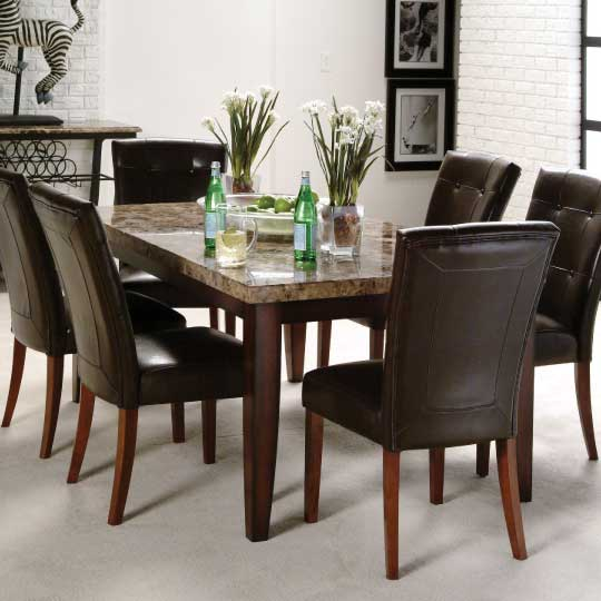 Brown tone marble dining table with rich stained wood legs and upholstered side chairs with button tufted backs