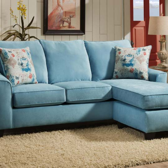 Light blue sofa with dramatic rolled arms and contemporary accent pillows