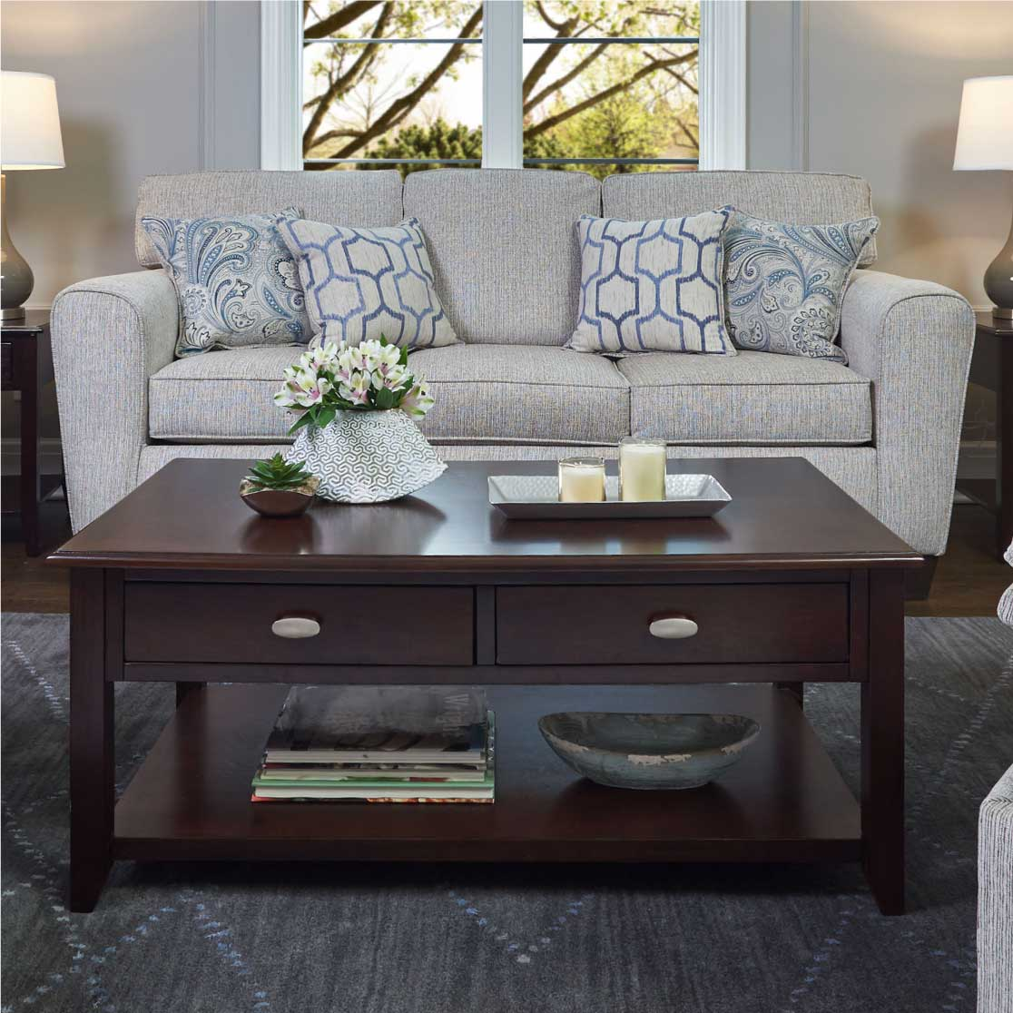 Contemporary living room sofa in beige with soft blue accent pillows