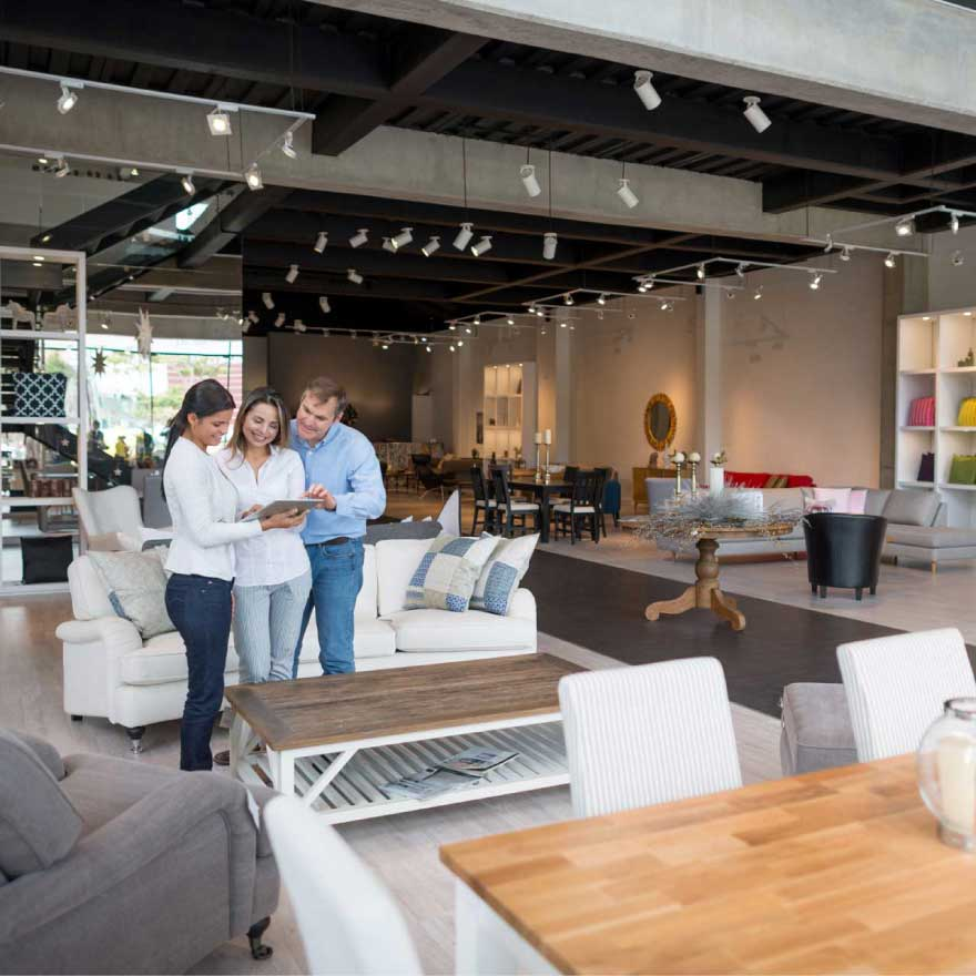 A couple getting help with their furniture purchase