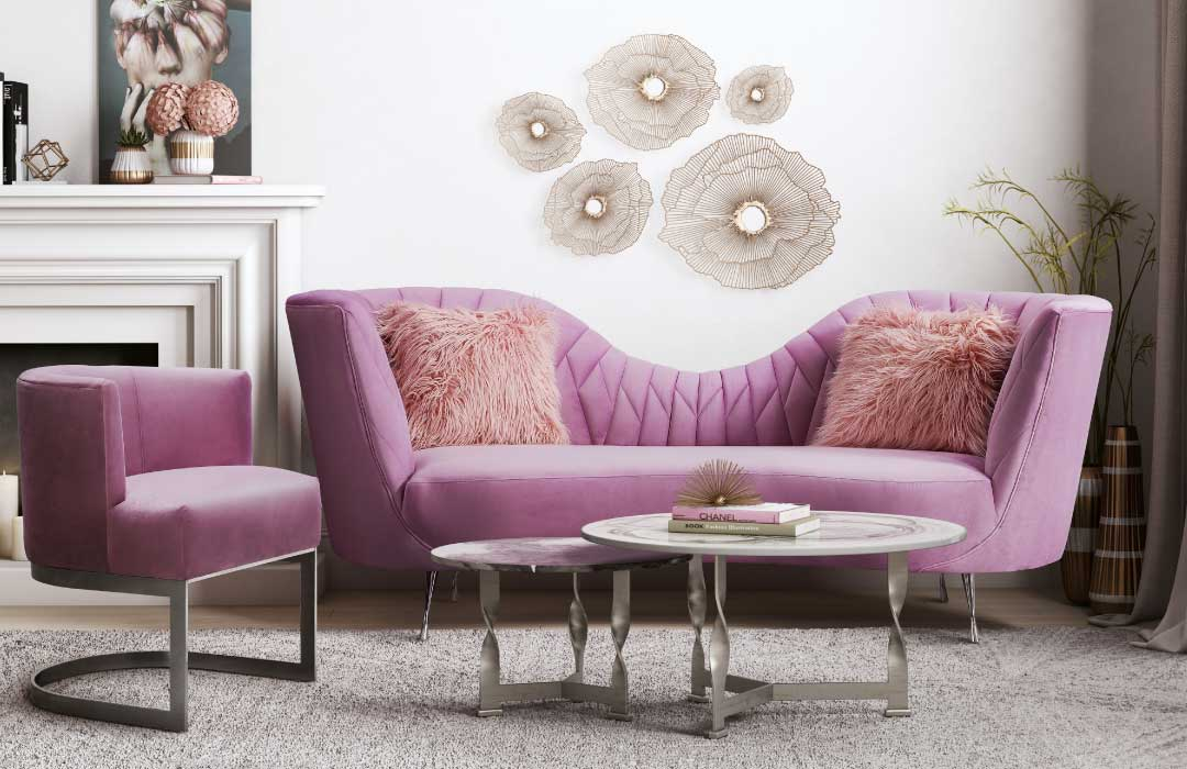 Contemporary room with a blush pink sofa that includes a dip in the middle of its back and a matching blush pink chair