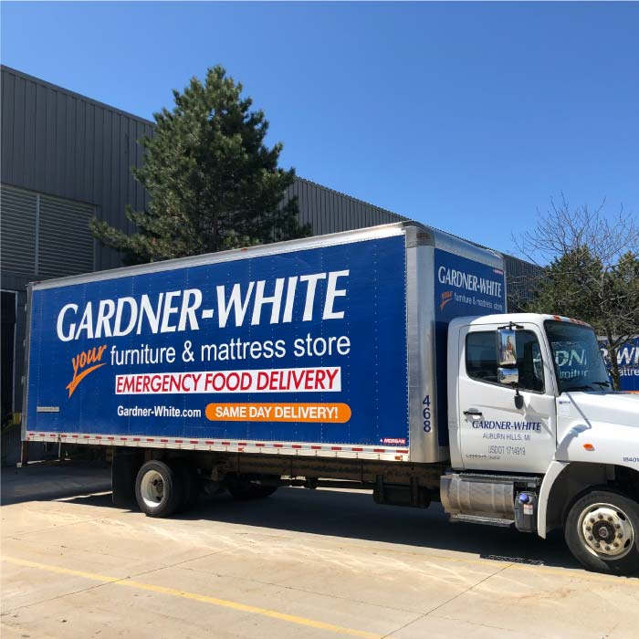 Gardner-White delivery truck making an emergency food delivery