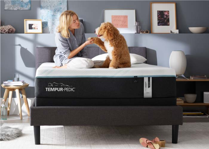Woman and her dog on a Tempur-Pedic Mattress