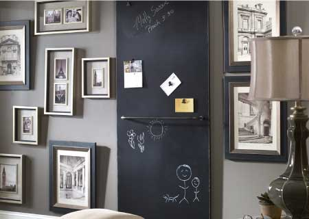 Decorated room with large barndoor-style chalkboard that also supports magnets