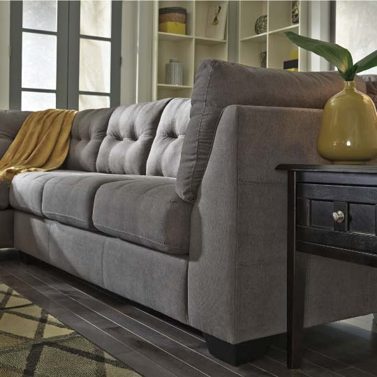 Grey contemporary sectional with tufted cushions
