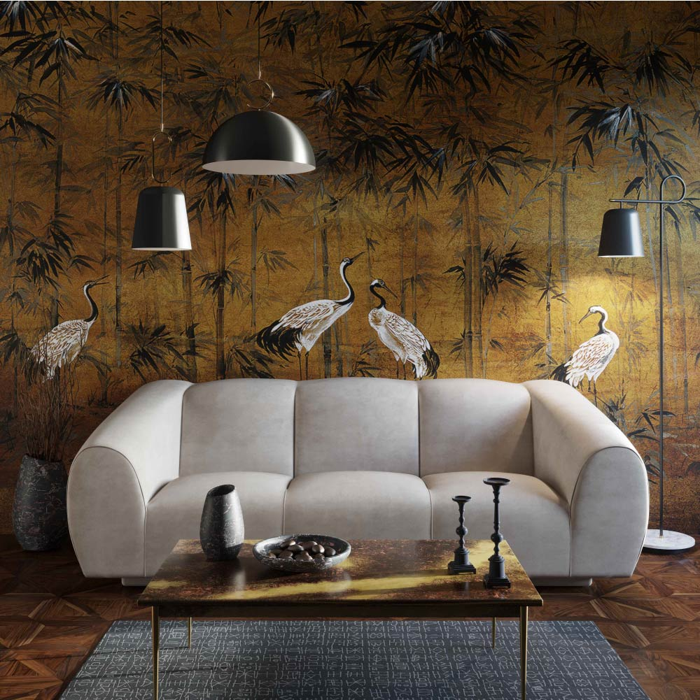 Modern sofa in beige and coffee table in front of a wall covered in cranes