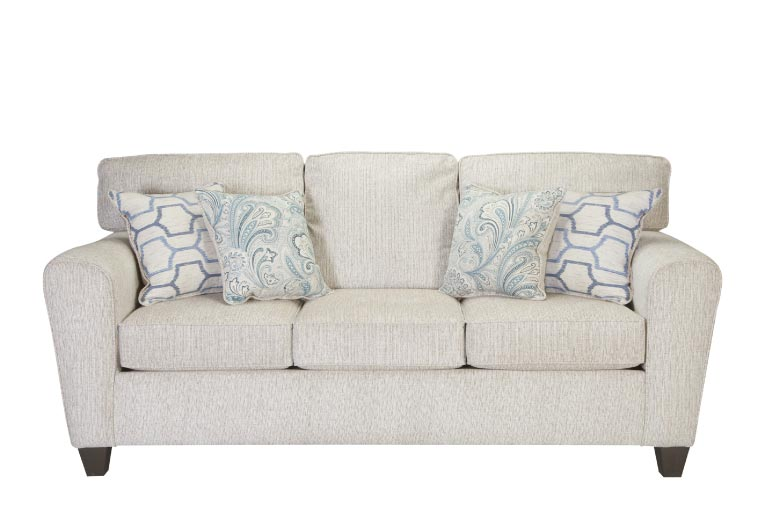 Cream-colored fabric contemporary sofa with light blue accent pillows