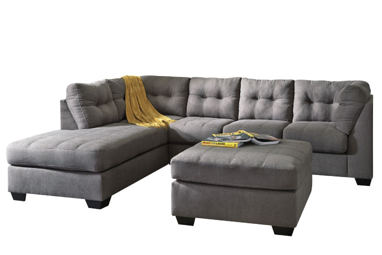 Grey contemporary sectional with tufted back, chaise on the left, and matching ottoman