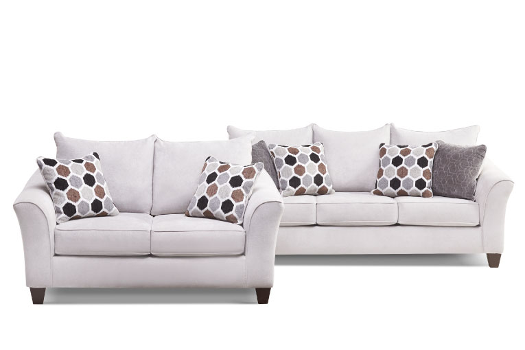 Dark grey-blue sofa and loveseat with tuxedo arms and accent pillows