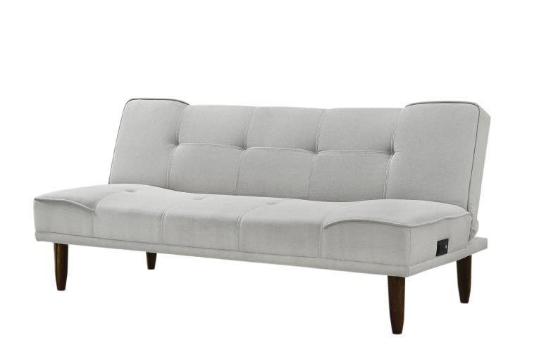 Grey mid-century modern inspired sofa with pull out bed made up with yellow comforter