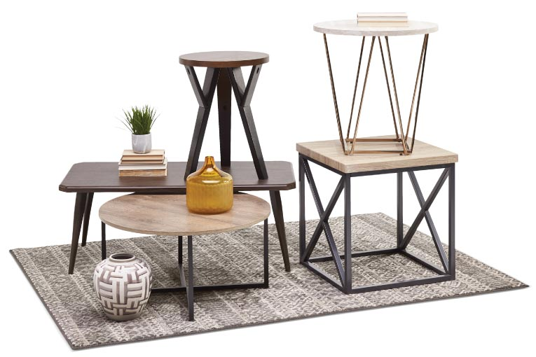 Coffee table and matching end tables with light grey ash tops and rectangular black metal bases with x-braces on the side