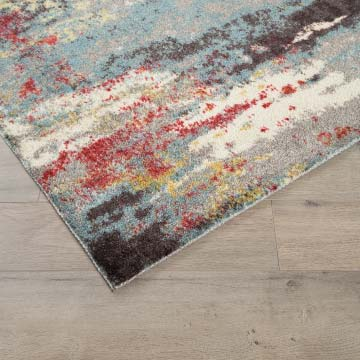 Corner of a colorful area rug