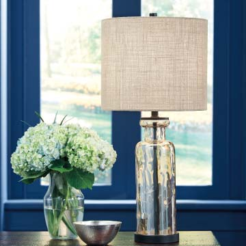 Glass table lamp in a blue room